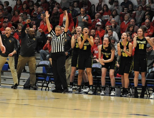 The Tri-Valley bench celebrates Lexi Howe's go-ahead 3 in the fourth quarter of the Division II regional semifinal on Tuesday at Zanesville. The Scotties won 50-48.