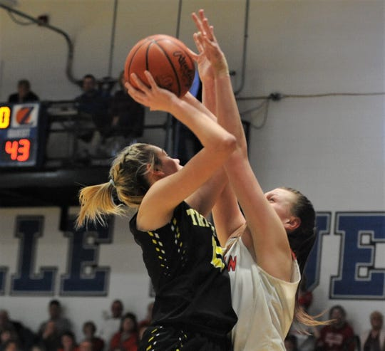 Tri-Valley's Riley Tracy goes up for a shot against Sheridan's Faith Stinson in the Division II regional semifinal on Tuesday at Zanesville. The Scotties won 50-48.