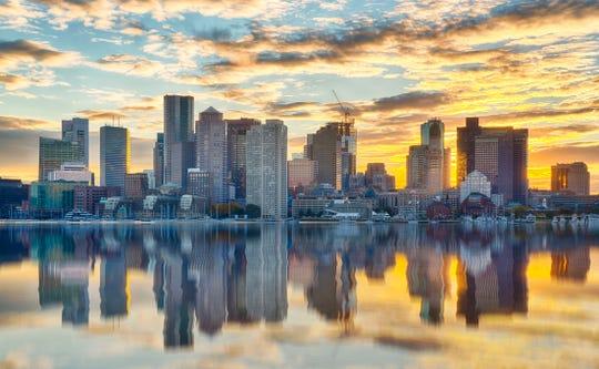 Boston skyline at sunset from across the harbor