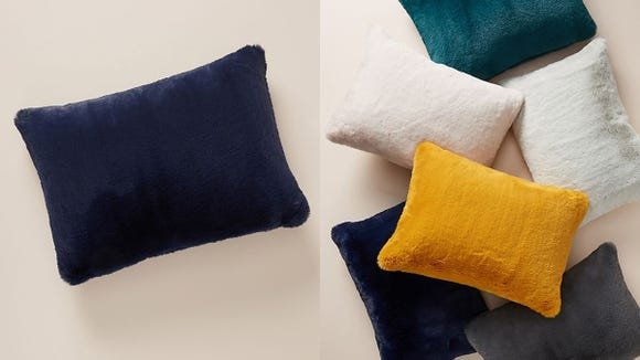 Cuddle early, cuddle often with these fuzzy throw pillows.