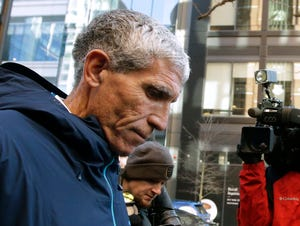 """In this March 12, 2019, file photo, William """"Rick"""" Singer departs federal court in Boston after pleading guilty to charges in a nationwide college admissions bribery scandal."""