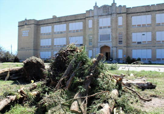 All but one tree at the entrance to the former Lincoln Middle School  have been removed or pulled as work continues to turn the site into Heritage Square, the city's future central library and other facilities. March 5 2020