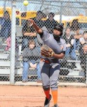 Rotan senior third baseman Mya Gentry makes a throw to first base against the Abilene High JV.