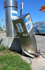 An air dispenser at a convenience store at Leggett Drive and South First Street, site of a Trump merchandise tent in December, is battered. Nearby, a speed limit sign has been felled, suggesting the corner has become dangerous without considering the presidential election. March 5 2020