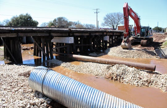 Rain Tuesday and Wednesday sent water into Catclaw as it crosses under South and North First streets, where Union Pacific crews are upgrading track track supports. Train traffic has been uninterrupted, officials said, and vehicle traffic continues almost normally.