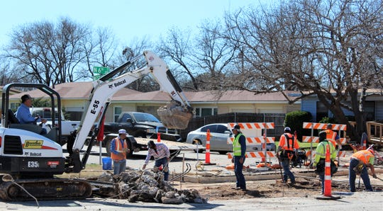 Crews begin repairs to North Sixth Street at its intersection with Westview on Thursday. North Sixth, from North First to Grape streets, will undergo some sort of upgrade this late winter and spring as part of the 2015 bond street project.