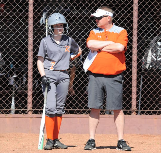 Rotan softball coach Greg Decker talks with right fielder Cissa Dixon during a pitching change against the Abilene High JV at the Eula tournament.