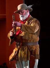 """Christopher Hull, a descendant of Erastus """"Deaf"""" Smith, performs a reenactment of him for students at Eastland's Majestic Theatre Thursday. Smith fought with Sam Houston for Texas independence in 1836."""