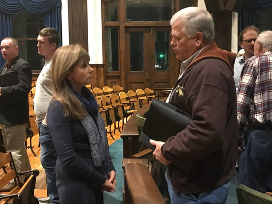 Deborah Mills, executive director of the School for Wholeness and Enlightenment, and Jimmy Ramsey, a neighbor opposed to the school's retreat center project, spoke after the Madison County planning board approved the center for 350 acres atop Upper Thomas Branch.
