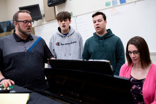 Pennfield choir director Steve Bowen, sophomore Antonio Fuentes, senior Zac Redfield and accompanist Melissa Sayles collaborate during choir class on Thursday, March 5, 2020 at Pennfield High School in Battle Creek, Mich.