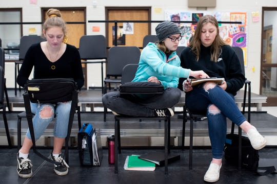 Junior Molly MacKenzie, junior Hailey Shemberger and senior Sydnee Ross collaborate during choir class on Thursday, March 5, 2020 at Pennfield High School in Battle Creek, Mich.