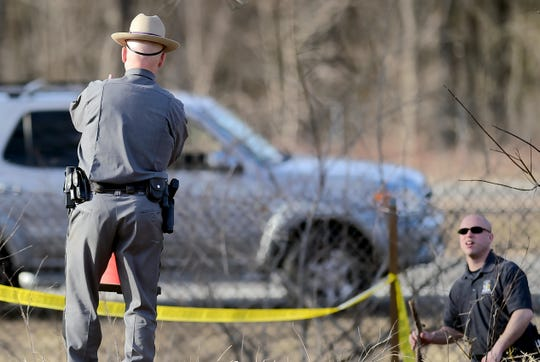 Law enforcement comb the scene where the body of Casie Weese was found in Apalachin, near Vestal, on Thursday, March 5 2020.