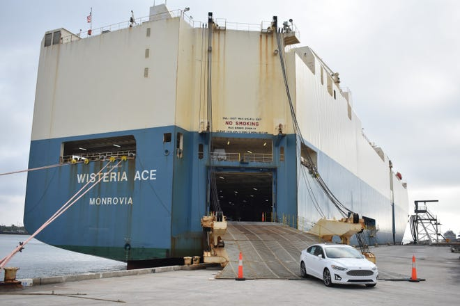 A vehicle roll off the Wisteria Ace vehicle carrier ship on Thursday morning at the auto processing facility at Port Canaveral's South Cargo Pier 4.