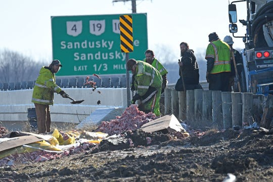 Cleanup was arduous Thursday after bulk raw pork spilled on U.S. 30 at 3:27 a.m.