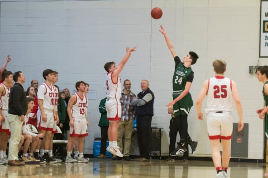 CVU's Ethan Harvey (5) shoots a three pointer over t. Johnsbury's Andrew Cowan (24) during the first game of the boys basketball semifinals between the Champlain Valley Union Redhawks and the St. Johnsbury Hilltoppers at Patrick Gym on Wednesday night March 4, 2020 in Burlington, Vermont.