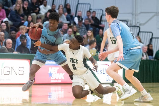 Rice's Mo Away (5) battles for the ball with South Burlington's Khalon Taylor (13) during the second game of the boys basketball semi finals between the South Burlington Wolves and the Rice Green Knights at Patrick Gym on Wednesday night March 4, 2020 in Burlington, Vermont.