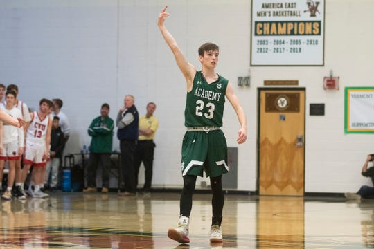 St. Johnsbury's Logan Wendell (23) celebrates after making a 3-pointer during the first game of the boys basketball semifinals between the Champlain Valley Union Redhawks and the St. Johnsbury Hilltoppers at Patrick Gym on Wednesday night March 4, 2020 in Burlington, Vermont.