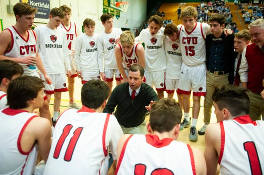 CVU head coach Michael Osborne talks to the team during a tie out in the first game of the boys basketball semifinals between the Champlain Valley Union Redhawks and the St. Johnsbury Hilltoppers at Patrick Gym on Wednesday night March 4, 2020 in Burlington, Vermont.