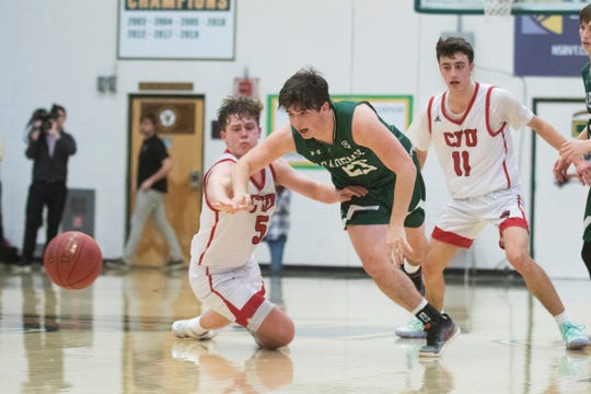 St. Johnsbury's Nick Guckin (25) battles for the loose ball with CVU's Ethan Harvey (25) during the first game of the boys basketball semifinals between the Champlain Valley Union Redhawks and the St. Johnsbury Hilltoppers at Patrick Gym on Wednesday night March 4, 2020 in Burlington, Vermont.