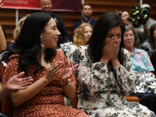 Monica Garcia, right, reaches to winning Corpus Christi Independent School District's teacher of the year, Wednesday, March 4, 2020, at the CCISD administration building. Garcia is a teacher at Hicks Elementary School.
