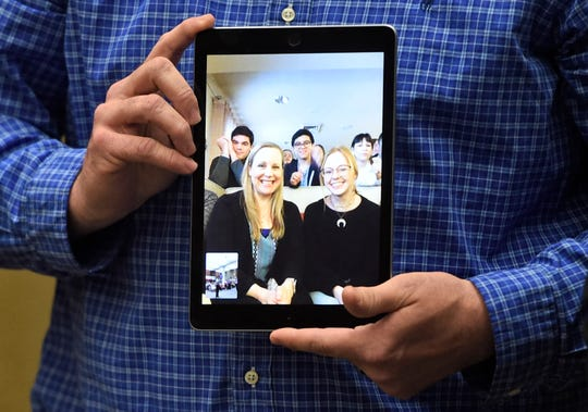 Veterans Memorial High School principal Scott Walker holds an iPad with Laurel Brashears watching, Wednesday, March 4, 2020, at the CCISD administration building. Brashears is the theater teacher at Veterans Memorial High School and won teacher of the year.