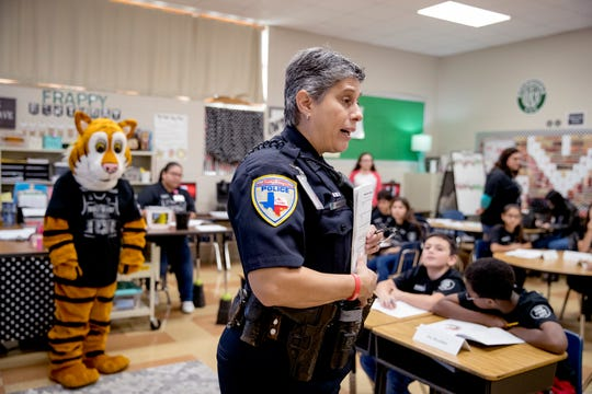 Sgt. Janelle Cantu with the Corpus Christi Independent School District Police Department talks with students at Oak Park Elementary School on the first day of the several week BullyProof Project on Thursday, March 5, 2020. Cantu began the program four years ago and is in the process of expanding it.