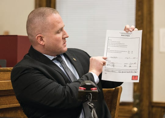 Lt. Detective Dustin Robinson holds up as he explains a Waiver of Rights document that Jordan Buckley signed before they interviewed him about the death of Victoria Schafer.