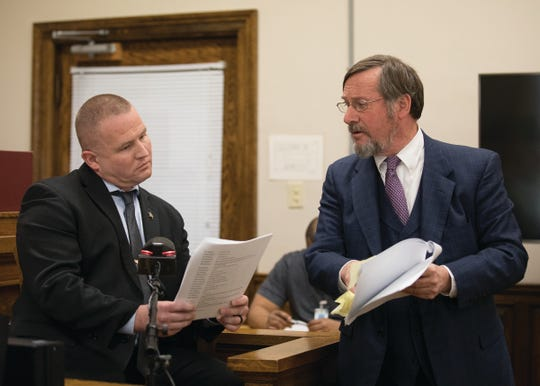 Defense attorney Bob Toy reviews statements from a transcript made by Detective Lt. Dustin Robison concerning the first interview Robinson had with Buckley.