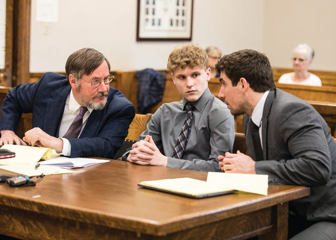 Jordan Buckley, middle, looks at attorney Andrew Grillo as he and head attorney Bob Toy discuss his case during a motion to suppress hearing regarding two earlier interviews Buckley gave to investigators concerning the events surrounding the death of Victoria Schafer. Schafer, a Chillicothe photographer, was killed when a 6-foot, 74-pound log was thrown or pushed off a cliff above Old Man's Cave and hit the photographer in the head. Buckley is charged with murder, involuntary manslaughter, and reckless homicide and is facing life in prison.