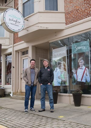 Gunner Barnes, left, and Fritz Schafer stand outside the second street studio opened by Victoria Schafer. They plan on keeping the studio open to honor the late photographer.