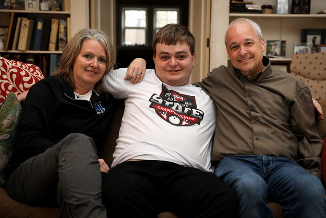 Luke Laskey, 19, sits for a portrait with his parents, Kris, left, and Paul, right, Monday, March 2, 2020, at the Laskey's home in Fort Thomas, Ky. The family had hoped Laskey could enter Project Search, a job training program through Northern Kentucky University and Campbell County Schools, after graduation to help his employment prospects.