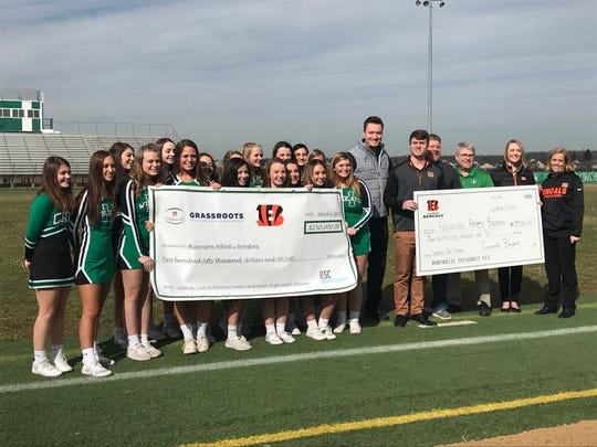 Cincinnati Bengals officials and Harrison High School members pose with a check the Bengals presented to help fund new athletic facilities.