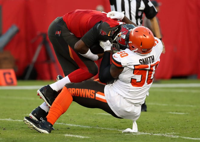 Cleveland Browns defensive end Chris Smith (50) sacks Tampa Bay Buccaneers quarterback Jameis Winston (3) during the first quarter at Raymond James Stadium in August 2019.