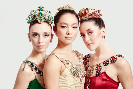 """A trio of Cincinnati Ballet dancers depict the three sections of George Balanchine's """"Jewels,"""" which will be performed Feb. 11-14 as part of the company's 2020-2021 season. Seen here are, from L, corps de ballet member Serena Helene Hanavan (Emeralds""""), principal dancer Sirui Liu (""""Diamonds"""") and corps de ballet member Samantha Griffin (""""Rubies"""")."""