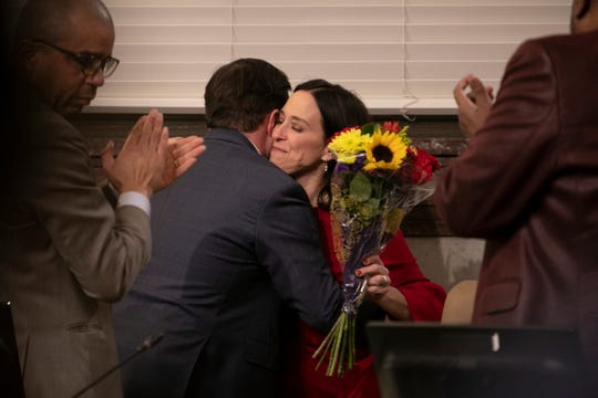 """Amy Murray hugs Mayor John Cranley during her last Cincinnati City Council meeting on Wednesday, March 4. Elizabeth """"Betsy"""" Sundermann, a Hamilton County probate court magistrate, will fill her seat."""