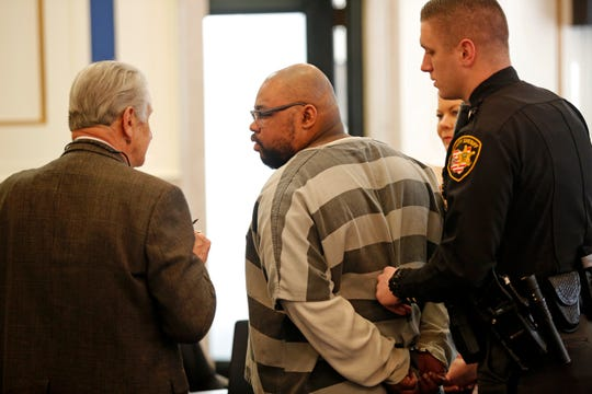Glen Bates speaks with his attorney, Perry Ancona, in Hamilton County Common Pleas Court on Thursday, March 5, 2020, before being led to the jail where he will be held until his next hearing. The Ohio Supreme Court last month overturned Bates' murder conviction in the 2015 killing of his 2-year-old daughter, Glenara.