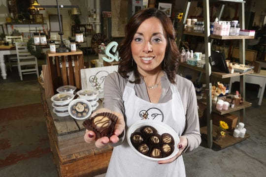 Tana Fischer, of Tana's Tasty Treats, holds one of her sought after buckeyes in Rust Decor in Coshocton. A month after posting pictures to Facebook in November 2018, she sold nearly 5,000 buckeyes.