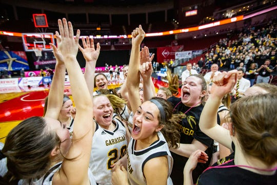 Bishop Garrigan celebrates after beating Martensdale-St. Marys in the quarterfinal round of the Iowa Girls' State Basketball Tournament at Wells Fargo Arena Wednesday, March 4, 2020.