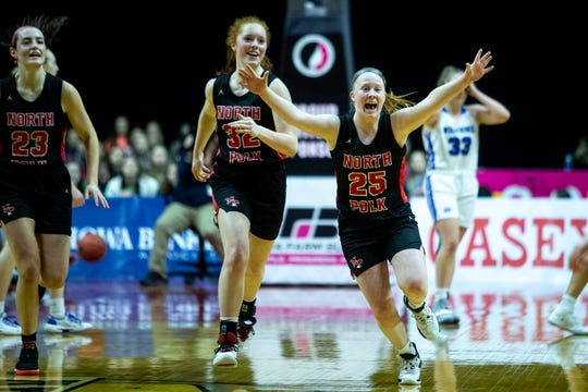 North Polk players celebrate winning the Iowa girls' state basketball tournament semifinal game between North Polk and Dike-New Hartford on Thursday, March 5, 2020, at Wells Fargo Arena in Des Moines.