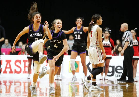 Members of the Johnston girls basketball team celebrate after beating Iowa City High during the Iowa high school girls basketball state tournament at Wells Fargo Arena in Des Moines on Thursday, March 5, 2020.