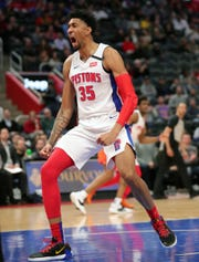 Detroit Pistons forward Christian Wood (35) reacts after a dunk against Oklahoma City Thunder center Steven Adams (12) during second period action Wednesday, March 4, 2020 at Little Caesars Arena in Detroit, Mich.