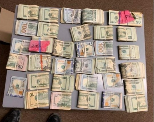 A look at come of the cash seized during a Michigan state police traffic stop.