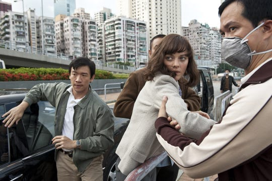 """Chin Han, left, as Sun Feng and Marion Cotillard, center, as Dr. Leonora Orantes in the thriller """"Contagion,"""" a Warner Bros. Pictures release. (Claudette Barius/Warner Bros. Pictures/MCT)"""