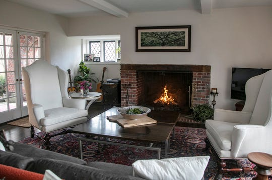 Grand living room with fireplace in this Brick Tudor Cotswald Cottage by Albert Kahn was the servants residence at the great Edsel and Eleanor Ford Estate in Grosse Pointe Shores. The house was photographed Wednesday, March 4, 2020 it also features a terra cotta roof, two-bedroom two bath and recently remodeled kitchen and first floor laundry.