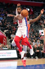 Jordan McRae makes a pass in his Pistons debut Wednesday.