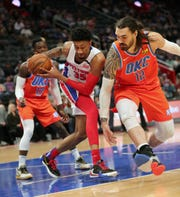 Christian Wood rebounds against Thunder center Steven Adams in the first quarter Wednesday at LCA.