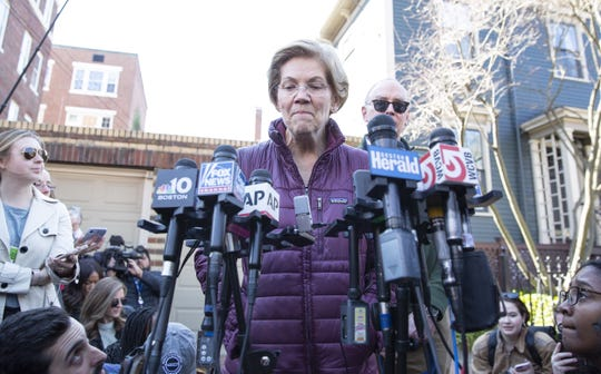 Senator Elizabeth Warren announces the suspension of her campaign for the Democratic presidential nomination on Thursday, March 5, 2020, outside her home in Cambridge, Massachusetts.