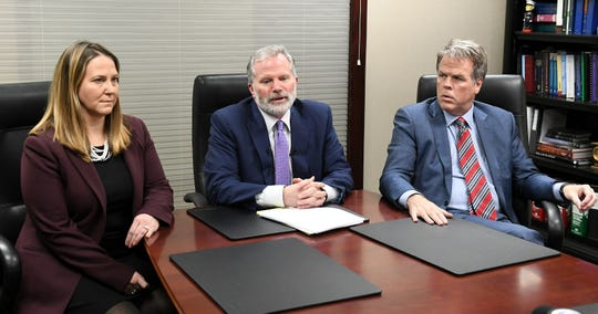 From left, Attorneys Jackie Cook, Mike Cox and David Shea hold a press conference regarding alleged sexual abuse claims by their clients against former University of Michigan doctor, Dr. Robert E. Anderson at the Mike Cox Law Firm office in Livonia, Mich. on Mar. 4, 2020.