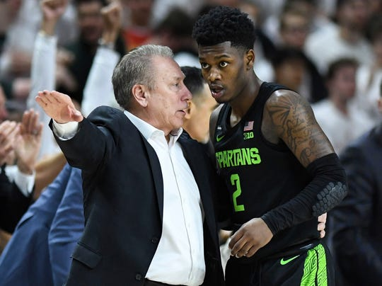Michigan State head coach Tom Izzo, left, talks with guard Rocket Watts against Maryland on Saturday in College Park, Md.