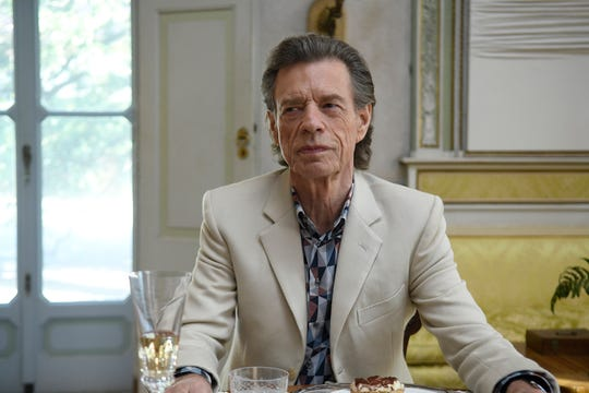 """This image released by Sony Pictures Classics shows Mick Jagger in a scene from the film, """"The Burnt Orange Heresy."""""""